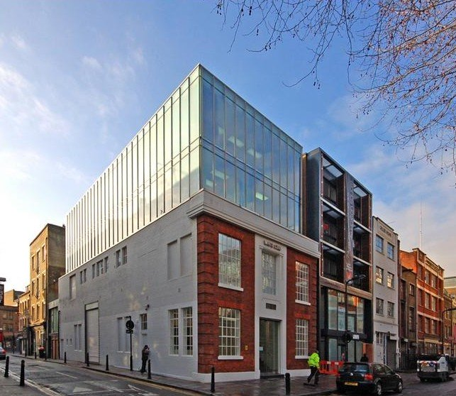 Glass and red brick warehouse conversion